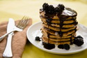 Stack of pancakes with blackberries