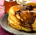 Pile of pancakes with melted chocolate